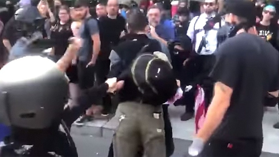 Paul Welch was beaten by Antifa members for carrying an American flag during a counter-protest in Portland, Oregon.