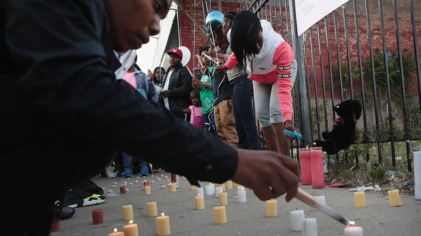CHICAGO, IL - JUNE 07:  Family, friends and supporters gather in the Bronzeville neighborhood for a vigil to honor 24-year--old Maurice Granton Jr. on June 7, 2018 in Chicago, Illinois. Granton was shot and killed in the neighborhood by police yesterday. Family members claim he was shot in the back while fleeing the police. Police have not yet released complete details of the shooting.  (Photo by Scott Olson/Getty Images)