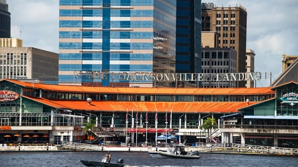 The Coast Guard patrols the St. Johns River outside The Jacksonville Landing in Jacksonville, Fla., Sunday, Aug. 26, 2018. Florida authorities are reporting multiple fatalities after a mass shooting at the riverfront mall that was hosting a video game tournament. (AP Photo/Laura Heald)