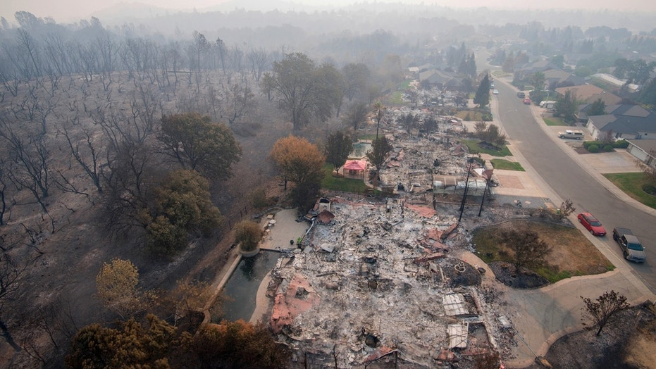 An aerial photo taken at the Mary Lake Subdivision in Redding, California, on August 10, 2018, sees homes destroyed by a wildfire.