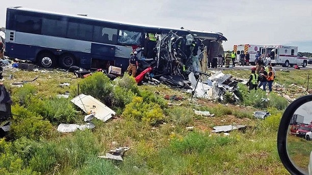 This photo provided by Chris Jones shows first responders working the scene of a collision between a Greyhound passenger bus and a semi-truck on Interstate 40 near the town of Thoreau, N.M., near the Arizona border, Thursday, Aug. 30, 2018. Multiple people were killed and others were seriously injured. Officers and rescue workers were on scene but did not provide details about how many people were killed or injured, or what caused the crash. (Chris Jones via AP)