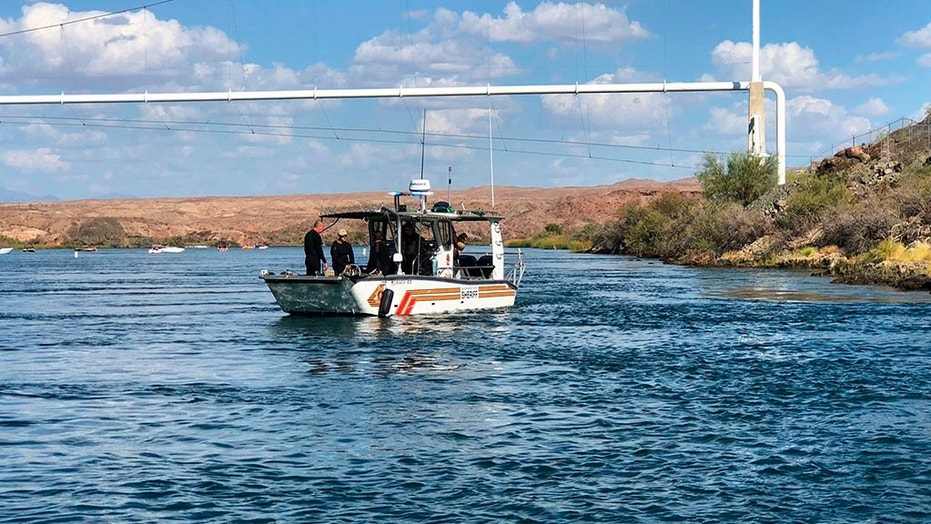 In this photo released by the San Bernardino County, Calif., Sheriff's Office, shows search and recovery operations Monday, Sept. 3, 2018, for three people missing after two boats collided Saturday evening on the Colorado River along the California-Arizona border near Topock, Ariz.