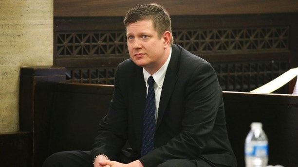 FILE - In this May 4, 2018 file photo, Chicago police Officer Jason Van Dyke attends a hearing for the shooting death of Laquan McDonald at the Leighton Criminal Court Building, in Chicago. Prospective jurors in the murder trial of the white Chicago police officer who killed the black teenager McDonald are to be given questionnaires as the first phase of jury selection starts Wednesday, Sept. 5, 2018. Van Dyke has pleaded not guilty. (Antonio Perez/Chicago Tribune via AP, Pool)