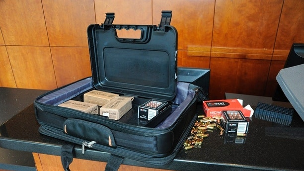 This image released by the Cincinnati Police Department on Friday, Sept. 7, 2018, shows a briefcase containing ammunition used by used by suspect Omar Enrique Santa Perez in a shooting incident the previous day in Cincinnati. (Cincinnati Police Department via AP)