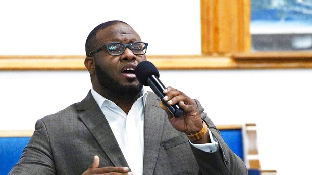 This Sept. 21, 2017, photo provided by Harding University in Search, Ark., shows Botham Jean leading worship at a university presidential reception in Dallas. Authorities said Friday, Sept. 7, 2018, that a Dallas police officer returning home from work shot and killed Jean, a neighbor, after she said she mistook his apartment for her own. The officer called dispatch to report that she had shot the man Thursday night, police said.  (Jeff Montgomery/Harding University via AP)