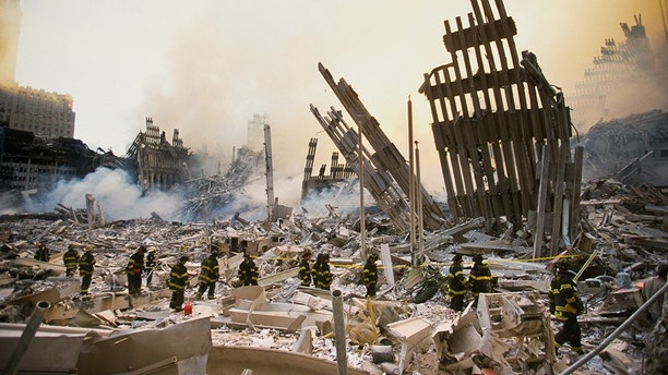 The rubble of the World Trade Center smoulders following a terrorist attack September 11, 2001 in New York. A hijacked plane crashed into and destroyed the landmark structure. (Photo by Porter Gifford/Corbis via Getty Images)