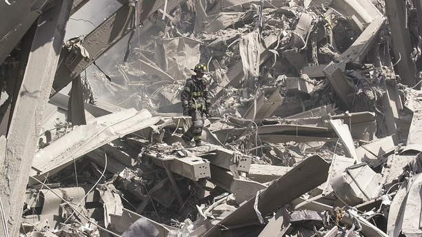 NEW YORK, NEW YORK - SEPTEMBER 11, 2001: Firefighters search for survivors after the collapse of the World Trade Center on Sept. 11, 2001. (Photo by Matt Moyer/Corbis via Getty Images)
