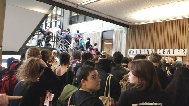 CORRECTS DESCRIPTION OF THE CAPTION AND DATE - In this Wednesday, May 24, 2017, photo, after weeks of brewing racial tension on campus, hundreds of students at the Evergreen State College in Olympia, Wash., protest against the college administration and demanded change. (Lisa Pemberton/The Olympian via AP)