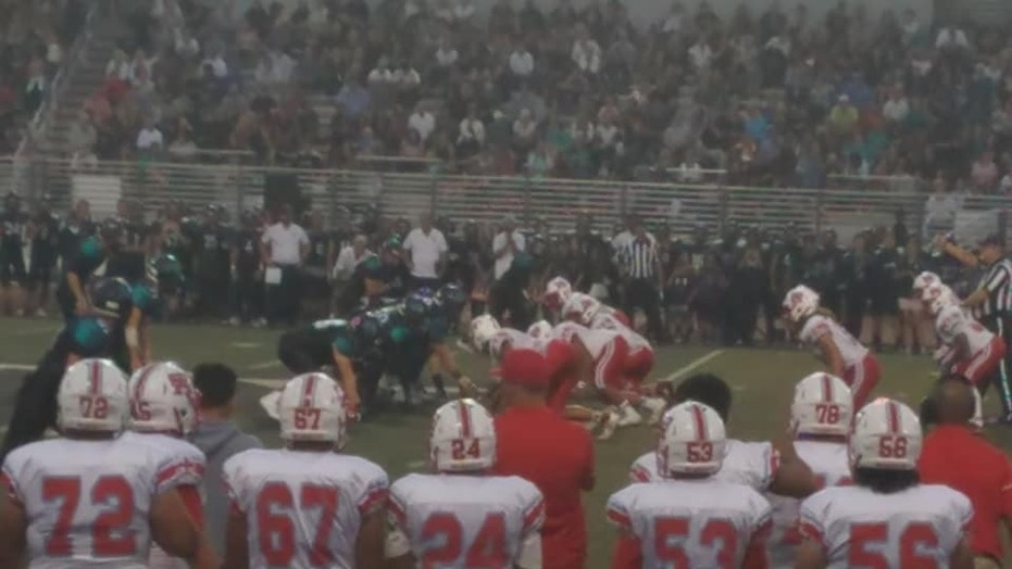 A high school coach in Orange County, Calif., said his team faced racist signs, chants during a football game.