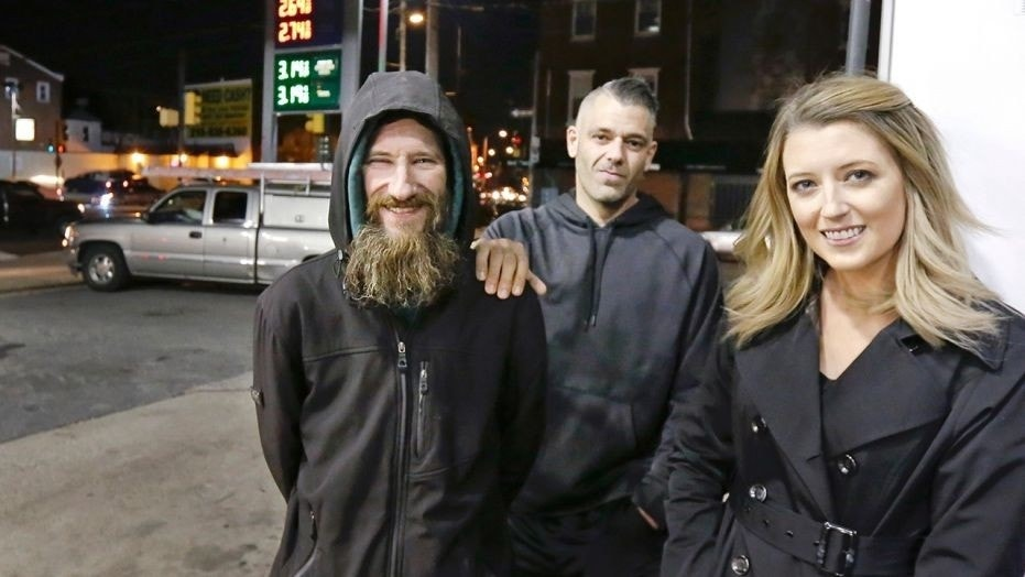 In happier times: Homeless good Samaritan Johnny Bobbitt, left, with Mark D'Amico and Kate McClure, who set up a GoFundMe page for Bobbitt.