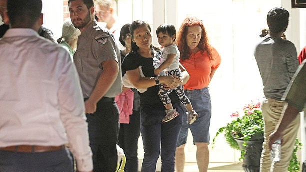 Residents are seeking shelter at a senior center after a series of fires and explosions Thursday, Sept. 13, 2018, in Andover, Mass. The company that owns Columbia Gas says its crews are performing safety checks after fires and explosions erupted in three communities north of Boston. (Suzanne Kreiter/The Boston Globe via AP)