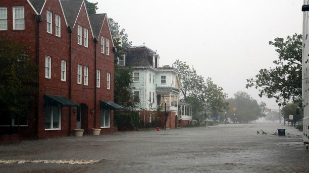 Flooding caused by Hurricane Florence covers blocks of Front Street in downtown New Bern, N.C.,  Friday, Sept. 14, 2018. (AP Photo/Chris Seward)