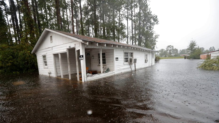 A home is seen in floodwaters from Hurricane Florence in Marion, S.C., Sunday, Sept. 16, 2018. (AP Photo/Gerald Herbert)