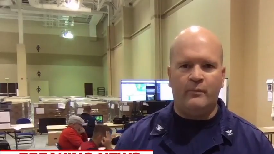 Coast Guard member flashes white power hand signal on TV