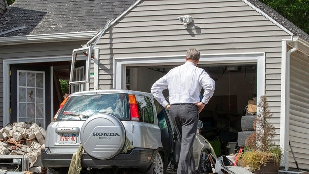 Massachusetts Gov. Charlie Baker tours 35 Chickering St. , where a young man was killed during a gas explosion in Lawrence, Mass, Friday, Sept. 14, 2018.
