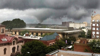 Funnel cloud hangs over the Richmond, Va., skyline, Monday, Sept. 2018.  (Bob Brown /Richmond Times-Dispatch via AP)