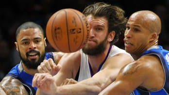 CORRECTS YEAR - Los Angeles Clippers forward Spencer Hawes, center, battles Dallas Mavericks center Tyson Chandler, left, and forward Richard Jefferson for a loose ball during the first half of an NBA basketball game in Los Angeles, Saturday, Jan. 10, 2015. (AP Photo/Alex Gallardo)