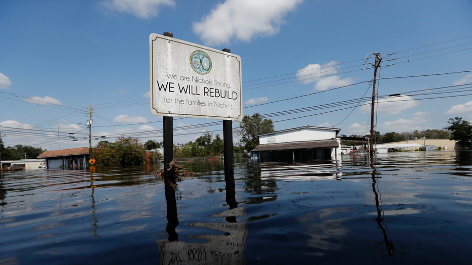 A sign commemorating the rebuilding of the town of Nichols which was flooded two years earlier from Hurricane Matthew stands in floodwaters in the aftermath of Hurricane Florence in Nichols S.C. Friday Sept. 21 2018. Virtually the entire town is onc