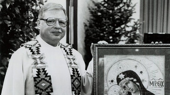 FILE -This 1989 file photo shows Father Arthur Perrault in Albuquerque, N.M. Perrault, a fugitive priest who fled the U.S. decades ago amid allegations of child sex abuse has been returned to New Mexico to face charges after being arrested in Morocco last year, federal officials said Friday, Sept. 21, 2018.  (The Albuquerque Journal via AP, File)
