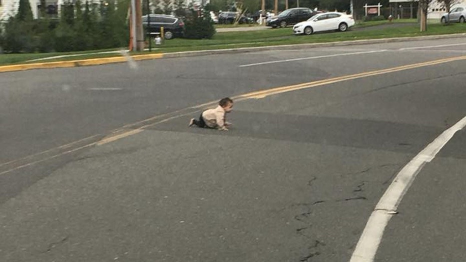 A baby boy was found crawling across a road in New Jersey on Sept. 22, prompting an investigation.