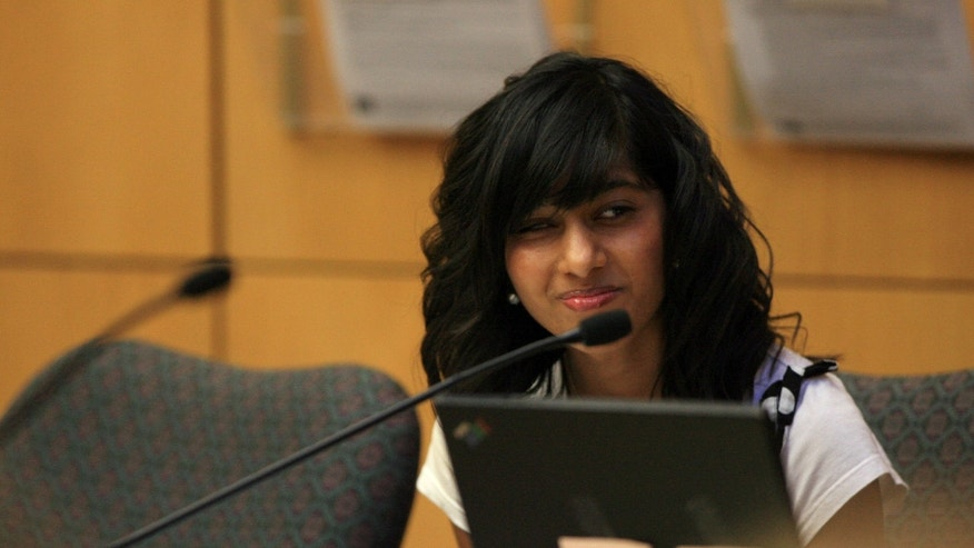 Rifqa Bary, 17, in the courtroom of circuit judge Daniel Dawson for her hearing at the Thomas S. Kirk Juvenile Justice Center in Orlando, on Tuesday, Oct. 13, 2009. A Florida judge says he plans to order the teenager who ran away from Ohio to Florida because she feared physical harm for converting from Islam to Christianity sent back to Ohio. (AP Photo/Orlando Sentinel, Ricardo Ramirez Buxeda)