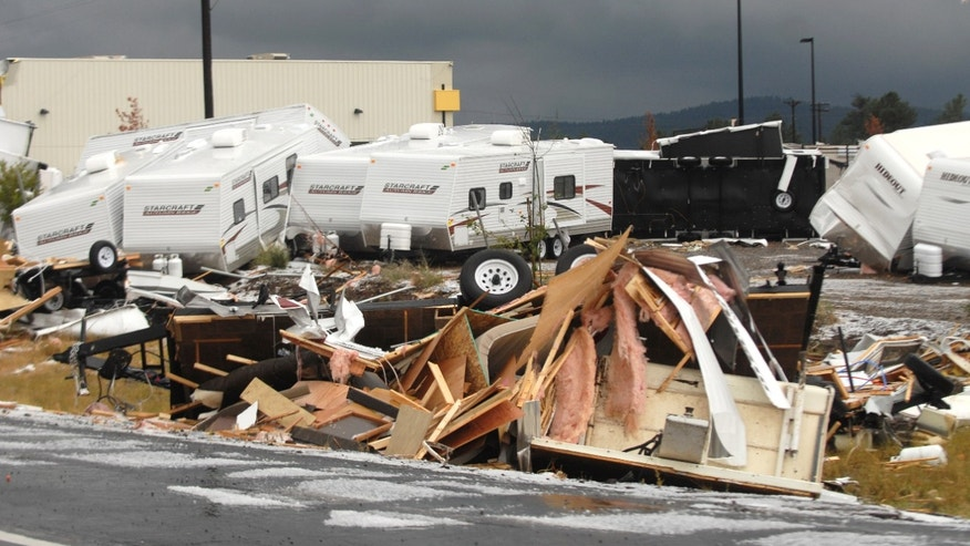 Trailers at Camping World in Bellemont, Ariz. are tossed throughout the area after a tornado struck the business on Wednesday, Oct. 6, 2010. Camping world is an RV business that sells campers and camper accessories. (AP Photo/Arizona Daily Sun, Josh Biggs)