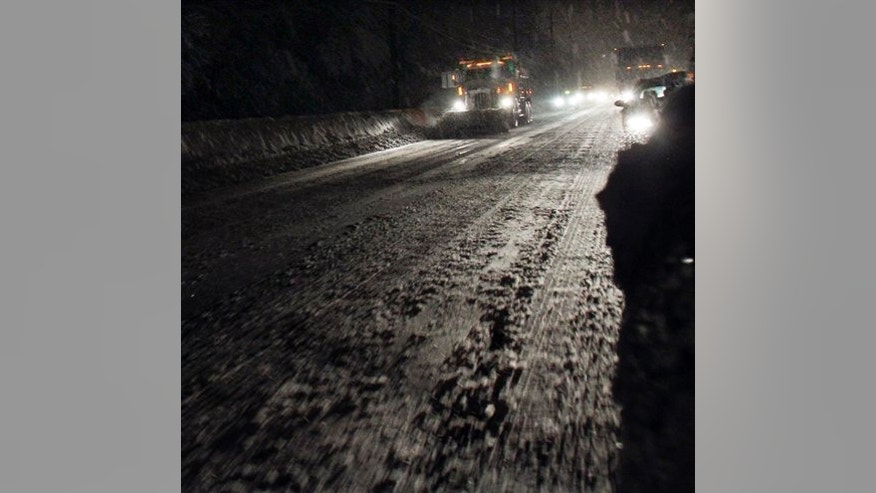 A snow plow works to clear Route 1 near Princeton, N.J., during a winter storm Thursday, Jan. 27, 2011. (AP Photo/Mel Evans)