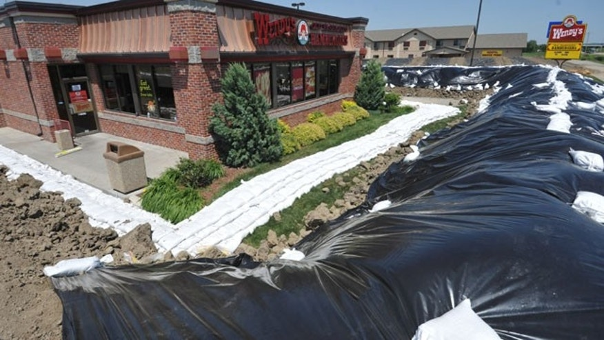 A Wendy's restaurant is surrounded by a temporary berm Monday June 6, 2011 in Hamburg, Iowa. The southwest Iowa town is under a mandatory evacuation order as the Missouri River continues to rise. (Photo/Dave Weaver)