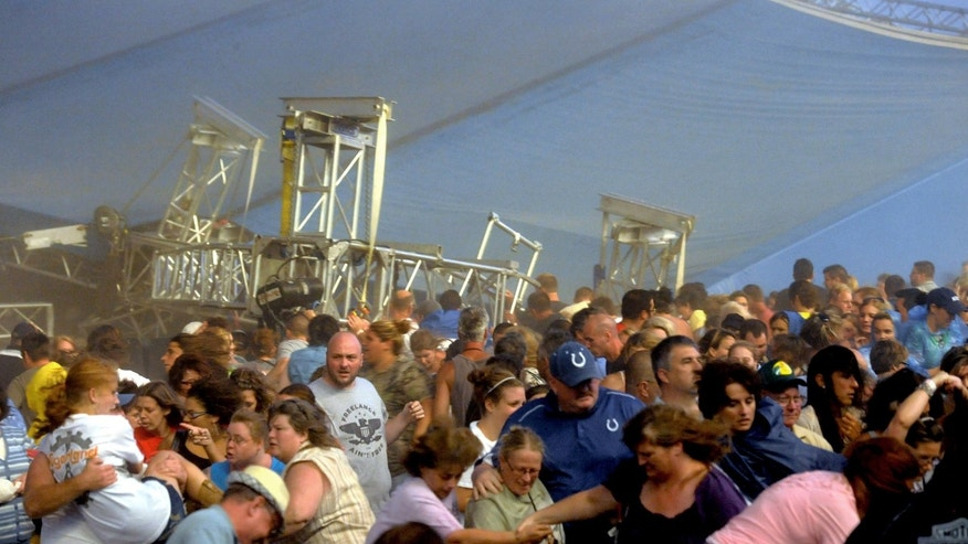 The overhead stage rigging collapses into the crowd in front of the stage at the Hoosier Lottery Grandstand at the Indiana State Fair, Saturday, Aug. 13, 2011, in Indianapolis. Authorities say they have confirmed at least three deaths after the stage collapse, where the country group Sugarland was set to perform. (AP Photo/The Indianapolis Star, Matt Kryger)