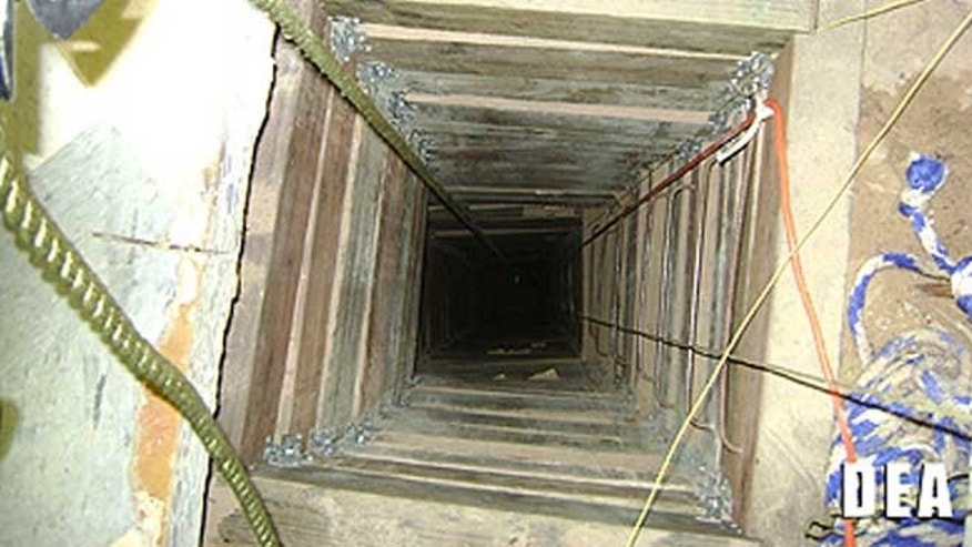 July 12, 2012: In this undated photo provided by the United States Drug Enforcement Administration, shows the tunnel shaft entrance on the U.S. side of a 240-yard, complete and fully operational drug smuggling tunnel.