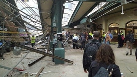 CORRECTS CREDIT AND SOURCE TO TWITTER USER @Cephster : This photo provided by Ian Samuel shows the scene of a train crash in Hoboken, N.J., on Thursday, Sept. 29, 2016.  A commuter train barreled into the New Jersey rail station during the Thursday morning rush hour, causing serious damage. The train came to a halt in a covered area between the station's indoor waiting area and the platform. A metal structure covering the area collapsed.  ( Twitter User @Cephster via AP)