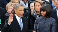 U.S. President Barack Obama recites his oath of office as first lady Michelle Obama looks on during swearing-in ceremonies on the West front of the U.S Capitol in Washington, January 21, 2013. REUTERS/Jim Bourg (UNITED STATES - Tags: POLITICS TPX IMAGES OF THE DAY) - RTR3CR2T