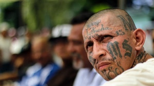Carlos Tiberio Ramirez, one of the leaders of the Mara Salvatrucha (MS-13) gang attends the Day of the Virgin of Mercy celebrations at the female prison in San Salvador September 24, 2012. About 2008 female inmates, 40% of them belonging to the MS-13 and 18 Street (Mara 18) gangs, interacted with their families as part of the celebrations for the Day of the Virgin of Mercy, the patron Saint of prisoners, local media reported.  During the event, the spokesmen and leaders of the two largest gangs in the country, MS-13 and 18st, gave a news conference to mark the 200-days of an unprecedented truce signed on March 19, that authorities say has cut the homicide rate in half in just four months. REUTERS/Ulises Rodriguez (EL SALVADOR - Tags: CIVIL UNREST CRIME LAW) - RTR38DOY