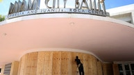 Edward Pastrana installs wood shutters at the Miami City Ballet in Miami Beach, Fla., Thursday, Sept. 7, 2017. The National Hurricane Center issued a hurricane watch for the Florida Keys and parts of South Florida. Mandatory evacuations were issued for the Florida Keys and coastal areas in South Florida. (AP Photo/Marta Lavandier)