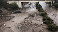 Abadoned cars stuck in flooded water on the freeway after a mudslide in Montecito, California, U.S. in this photo provided by the Santa Barbara County Fire Department, January 9, 2018.   Mike Eliason/Santa Barbara County Fire Department/Handout via REUTERS     ATTENTION EDITORS - THIS IMAGE WAS PROVIDED BY A THIRD PARTY. - RC136C93CE60