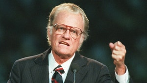 FILE - In this Oct 26, 1994 file photo, Evangelist Billy Graham begins his sermon in Atlanta's Georgia Dome.   Graham, who transformed American religious life through his preaching and activism, becoming a counselor to presidents and the most widely heard Christian evangelist in history, has died. Spokesman Mark DeMoss says Graham, who long suffered from cancer, pneumonia and other ailments, died at his home in North Carolina on Wednesday, Feb. 21, 2018. He was 99. (AP Photo/John Bazemore, File)