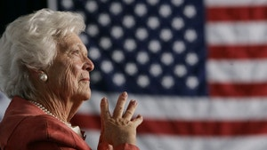 Former U.S. first lady Barbara Bush listens to her son, President George W. Bush, as he speaks at an event on social security reform in Orlando, Florida, March 18, 2005. Barbara Bush introduced President Bush at the event as part of a two-stop trip to Florida on Friday to discuss his social security plan for the future. REUTERS/Jason Reed  JIR/HB - RP6DRMSFZMAA