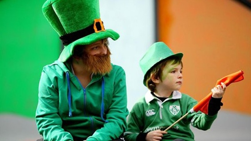 March 17: Children dressed as Leprechauns watch the St Patrick's Day parade in Dublin, Ireland.