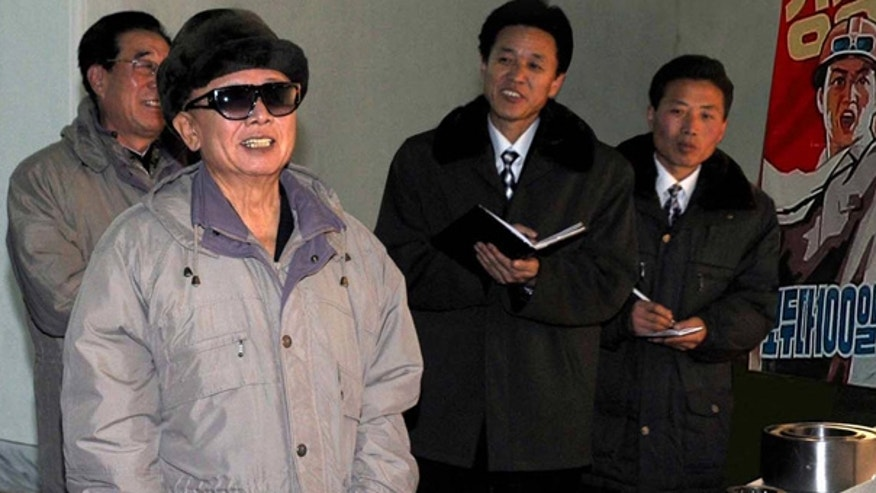 Nov. 25: North Korean leader Kim Jong Il smiles as he visits a bearing factory. (KCNA via AP)