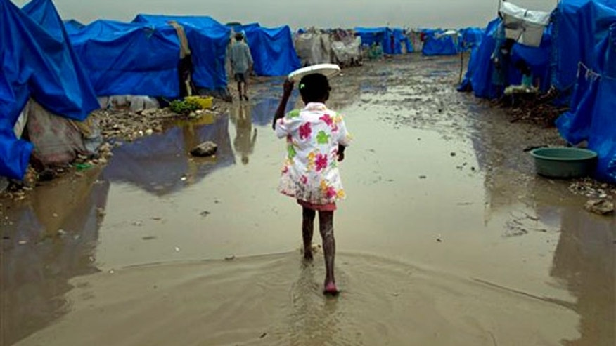 March 19: A girl walks at a homeless earthquake survivors camp during heavy rains in Port-au-Prince, Haiti.