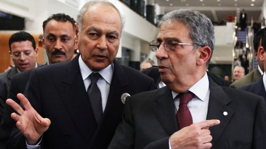 March 25: Arab League Secretary General Amr Moussa, right, and Egyptian Foreign Minister Ahmed Aboul Gheit talk while leaving an Arab League Foreign Ministers meeting.