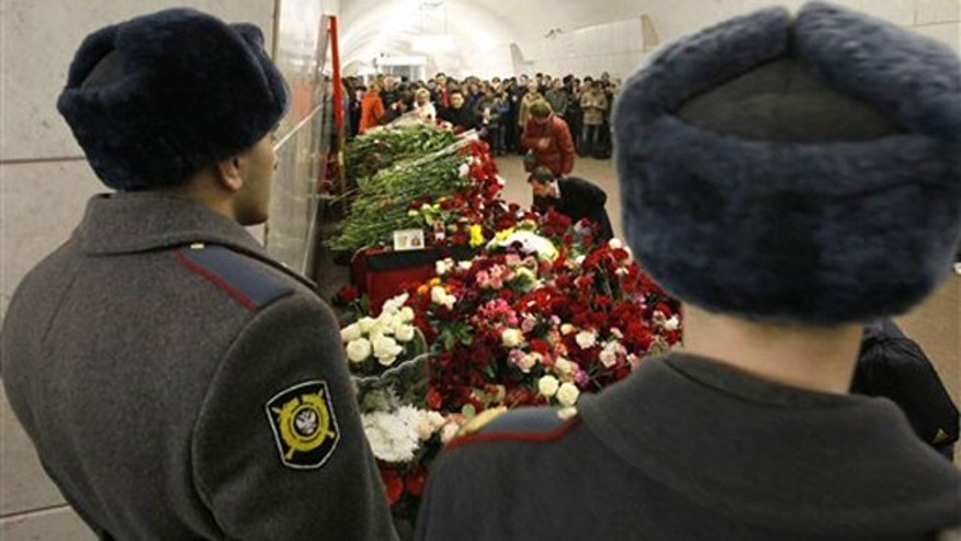 March 30: People place flowers at the sight of the explosion at Lubyanka subway station in Moscow, Russia.