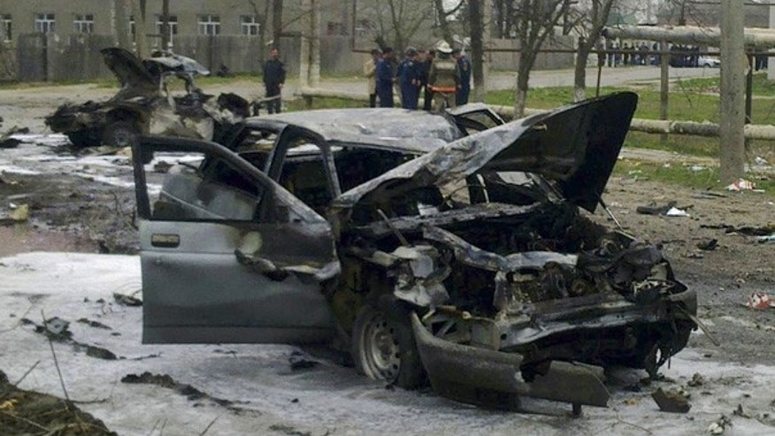 Mar. 31: Destroyed cars are seen after a homicide blast in Kizlyar, southern Russia.