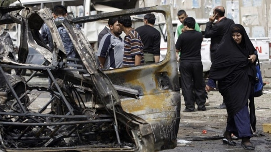 April 4: Iraqis inspect the site of a car bomb attack near the Iranian Embassy in Baghdad, Iraq. (AP)