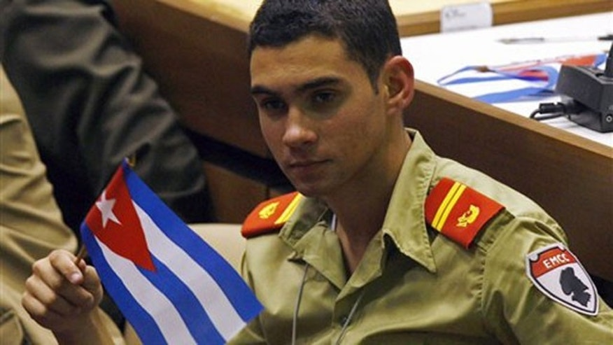 April 4: Elian Gonzalez holds a Cuban flag during the UJC, Union of Young Communists, congress in Havana.