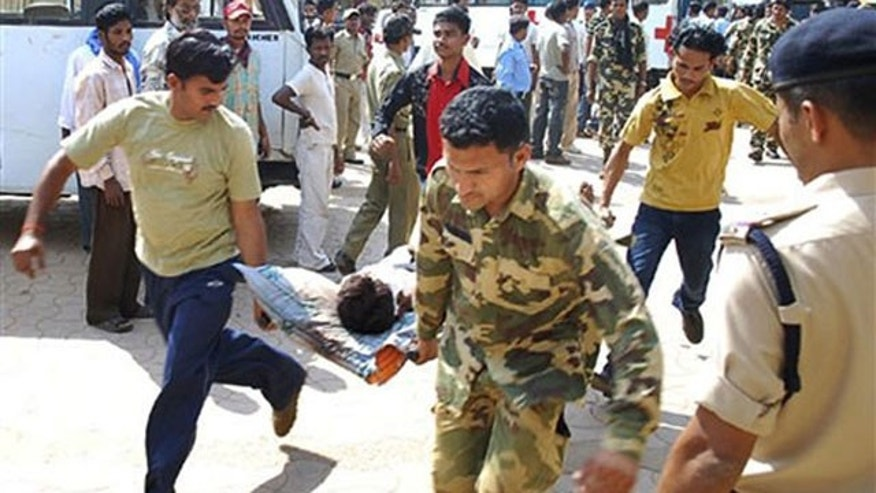 April 6: Men carry an injured paramilitary soldier for treatment at Jagdalpur, in the eastern Indian state of Chhatisgarh.