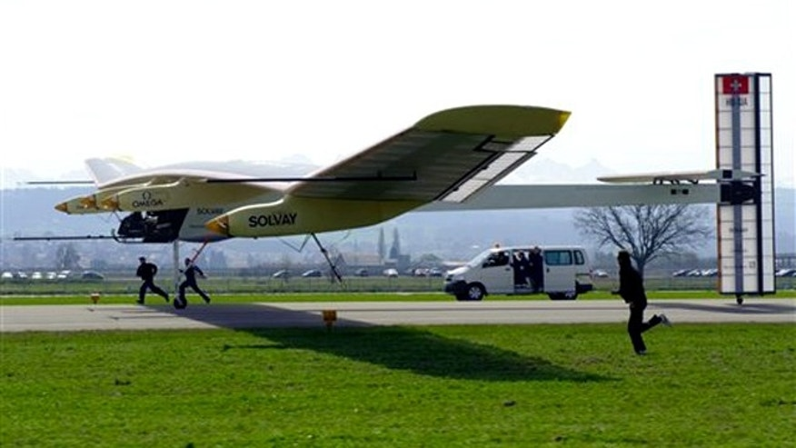 "The solar powered aircraft ""Solar Impulse"" (HB-SIA prototype) steered by test pilot Markus Scherdel lands after its maiden flight at the military airport in Payerne, Switzerland, Wednesday, April 7, 2010. The prototype with the wingspan of a Boeing 747 and the weight of a small car  started to a two-hour test flight to examine if the plane can keep a straight trajectory. The Solar Impulse project aims to circumnavigate the world with an aircraft powered only by solar energy."