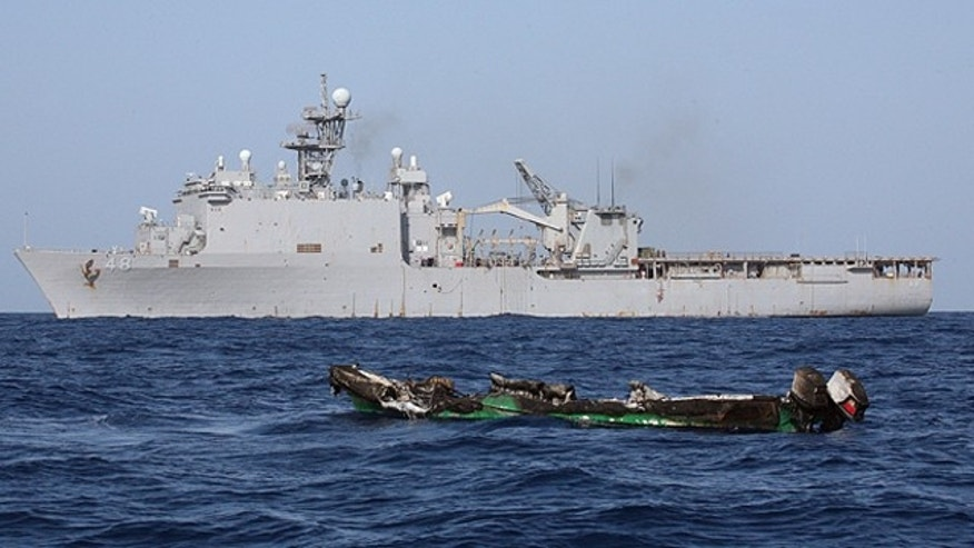 April 10: Suspected pirates skiff drifts at sea after being burnt the amphibious dock landing ship USS Ashland.