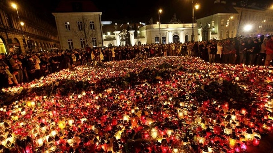 April 10: People place candles and lay flowers in front of the presidential palace in Warsaw, Poland. (AP)