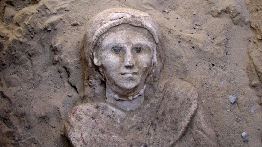 A 3-foot tall intricately carved plaster sarcophagus portraying a wide-eyed woman dressed in a tunic was found in a newly uncovered complex of tombs at the remote Bahariya desert oasis area 186 miles southwest of Cairo in Egypt. Archaeologist Mahmoud Afifi, who led the dig, said the new find had not been dated but the burial style indicated the sarcophagus belonged to Egypt's long period of Roman rule, from 31 B.C. until the Arab invasions of the 7th century.